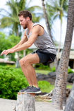 Fitness athlete bench jump squat jumping outside Stock Photos
