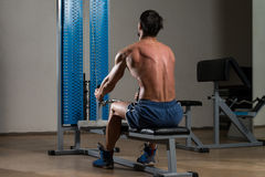 Fitness Athlete Doing Heavy Weight Exercise For Back Royalty Free Stock Photos