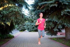 Fitness athlete training alone. Woman runner jogging outdoors. E. Xercising for healthy lifestyle and wellness royalty free stock photography