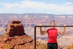 Fitness athlete training pull ups in Grand Canyon royalty free stock images