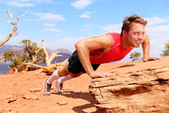 Fitness athlete training push ups in nature Royalty Free Stock Image