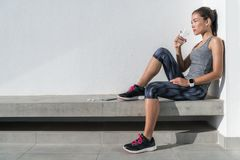 Fitness athlete woman drinking water on workout. Fitness athlete woman drinking water during cardio workout break Healthy living hydration concept. Runner woman stock image