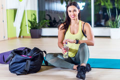 Fitness athlete woman drinking water after Royalty Free Stock Image