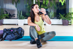 Fitness athlete woman drinking water after Stock Photos