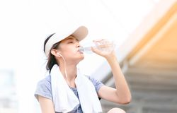 Fitness athlete woman drinking water after work out exercis royalty free stock images
