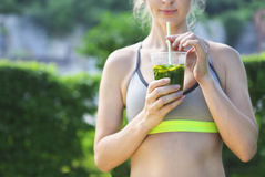 Fitness athlete woman resting drinking organic drink Royalty Free Stock Image