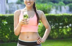 Fitness athlete woman resting drinking organic drink Stock Photos