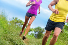 Fitness athletes trail running - athletic legs Royalty Free Stock Images