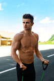 Fitness Athletic Muscular Man Exercising,  Doing Expander Workout Stock Images