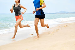 Fitness. Athletic Runners Legs Running On Beach. Exercising. Healthy Lifestyle. Fitness. Closeup Of Athletic Runners Legs Running On Beach. Sporty Fit Couple royalty free stock images