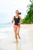 Fitness. Athletic Woman Running On Beach. Sports, Exercising, He Stock Photography