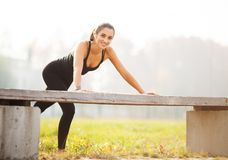 Fitness. Athletic woman standing in plank position outdoors at sunset. Concept of sport, recreation and motivation stock photo
