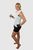 Fitness attire. Attractive young woman wearing workout attire holding a water bottle Stock Images