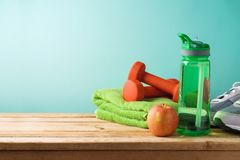 Fitness background with bottle of water, dumbbells and towel royalty free stock photos