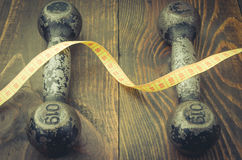 Fitness background with dumbbell black steel and centimeter. Fitness concept with dumbbell black steel and centimeter Royalty Free Stock Photos