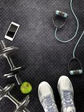 Fitness background with dumbbells and smartphone. 3D rendering of Fitness background with dumbbells and smartphone Royalty Free Stock Images