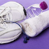 Fitness background, sneakers, headphones, water bottle and towel Stock Image