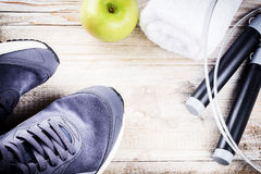 Fitness background with sneakers and skipping rope. Healthy life Royalty Free Stock Photos