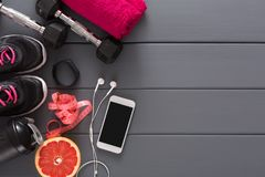 Fitness background, sport equipment, copy space. Fitness background, sport equipment, top view, copy space. Dumbbells, grapefruit, sneakers, bottle, measuring Royalty Free Stock Images
