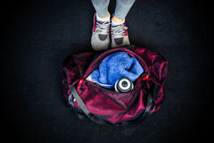 Fitness bag with female legs Royalty Free Stock Photos