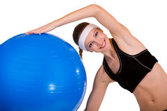 Fitness ball. Portrait of strong girl lifting fitball on a white background Stock Photography