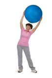 Fitness ball. Senior woman exercising in gym with fitball Royalty Free Stock Image