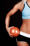 Fitness ball in hands. Image of orange fitness ball in girls hands Royalty Free Stock Photography