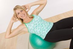 Fitness Ball situps stock images
