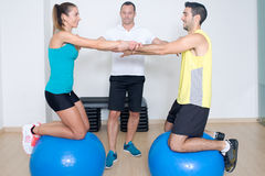 Fitness ball training with coach Stock Image