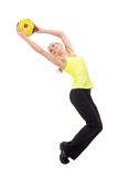 Fitness with ball: young woman doing exercises. Fitness with med ball: beautiful young woman doing exercises with ball . Yellow and black color Royalty Free Stock Images