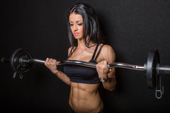 Woman training with barbell Royalty Free Stock Photos