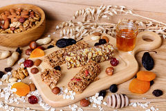 Fitness bars with granola, oatmeal, nuts, dried fruit and honey Stock Photo