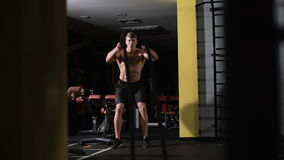 Fitness battling ropes at gym workout fitness exercise. Cardio workout stock video