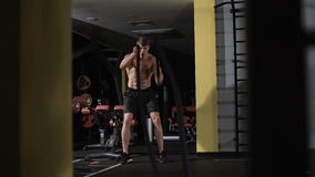 Fitness battling ropes at gym workout fitness exercise. Cardio workout stock video footage