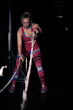 Fitness battling ropes at gym workout fitness exercise.Young woman doing some crossfit exercises with a rope at a gym Stock Photo
