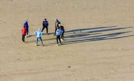 Fitness on the beach. A small group men and women are buzy with  fitness on the beach of Vlissingen, the Netherlands. Photo was taken early in the morging with Stock Image