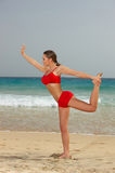 Fitness on beach. Young beautiful woman during fitness on sea beach Stock Photos