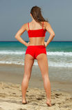 Fitness on beach. Young beautiful woman during fitness on sea beach Royalty Free Stock Images