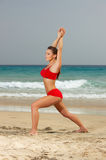 Fitness on beach. Young beautiful woman during fitness on sea beach Stock Photo