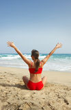 Fitness on beach. Young beautiful woman during fitness on sea beach Stock Photography