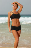 Fitness on beach. Young beautiful woman during fitness on sea beach Royalty Free Stock Photos