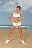 Fitness on beach. Young beautiful woman during fitness on sea beach Royalty Free Stock Photo