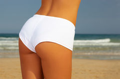 Fitness on beach. Young beautiful woman during fitness on sea beach Stock Images