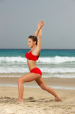 Fitness on beach. Young beautiful woman during fitness on sea beach Royalty Free Stock Photography