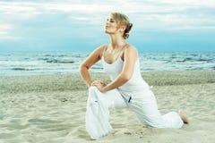 Fitness on the beach. Stock Photos