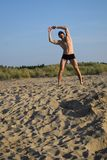 Fitness on the beach. The man has fitness on the beach Stock Photos