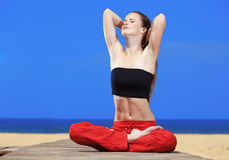 Fitness the beach. Young beautiful woman doing fitness exercises at the beach Royalty Free Stock Photos