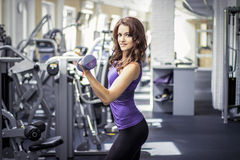 Fitness beautiful girl in gym Stock Photography