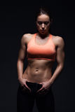 Fitness. Beautiful girl with muscular body posing. Fitness concept Royalty Free Stock Photo