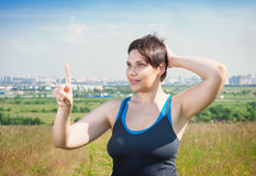Fitness beautiful plus size woman making choice Stock Images